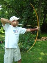 Delbert draws his new Cherokee style osage bow, 'Rainbow'