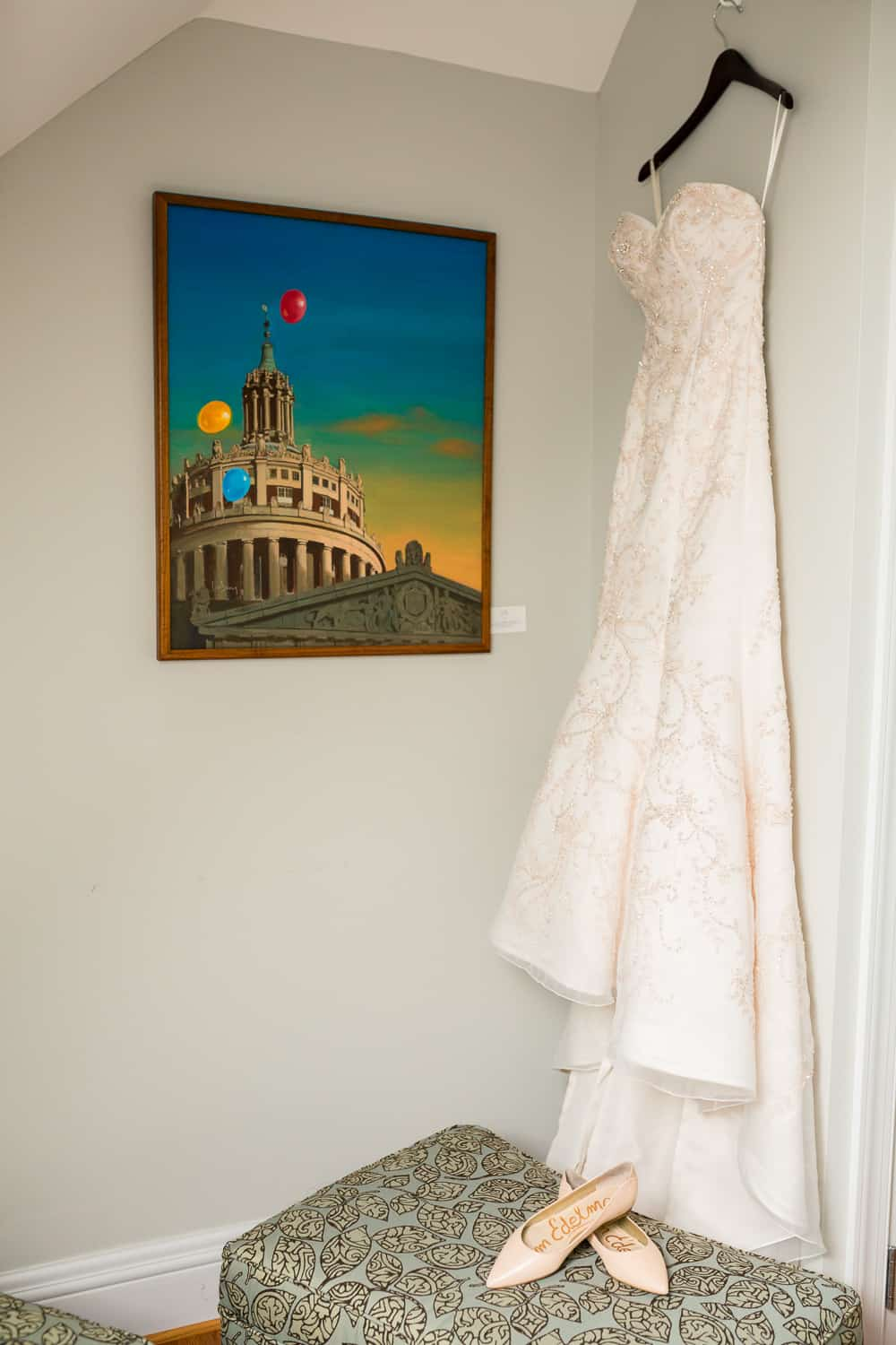 Casablanca dress from Blissette's hanging next to a painting of Rush rhees library.