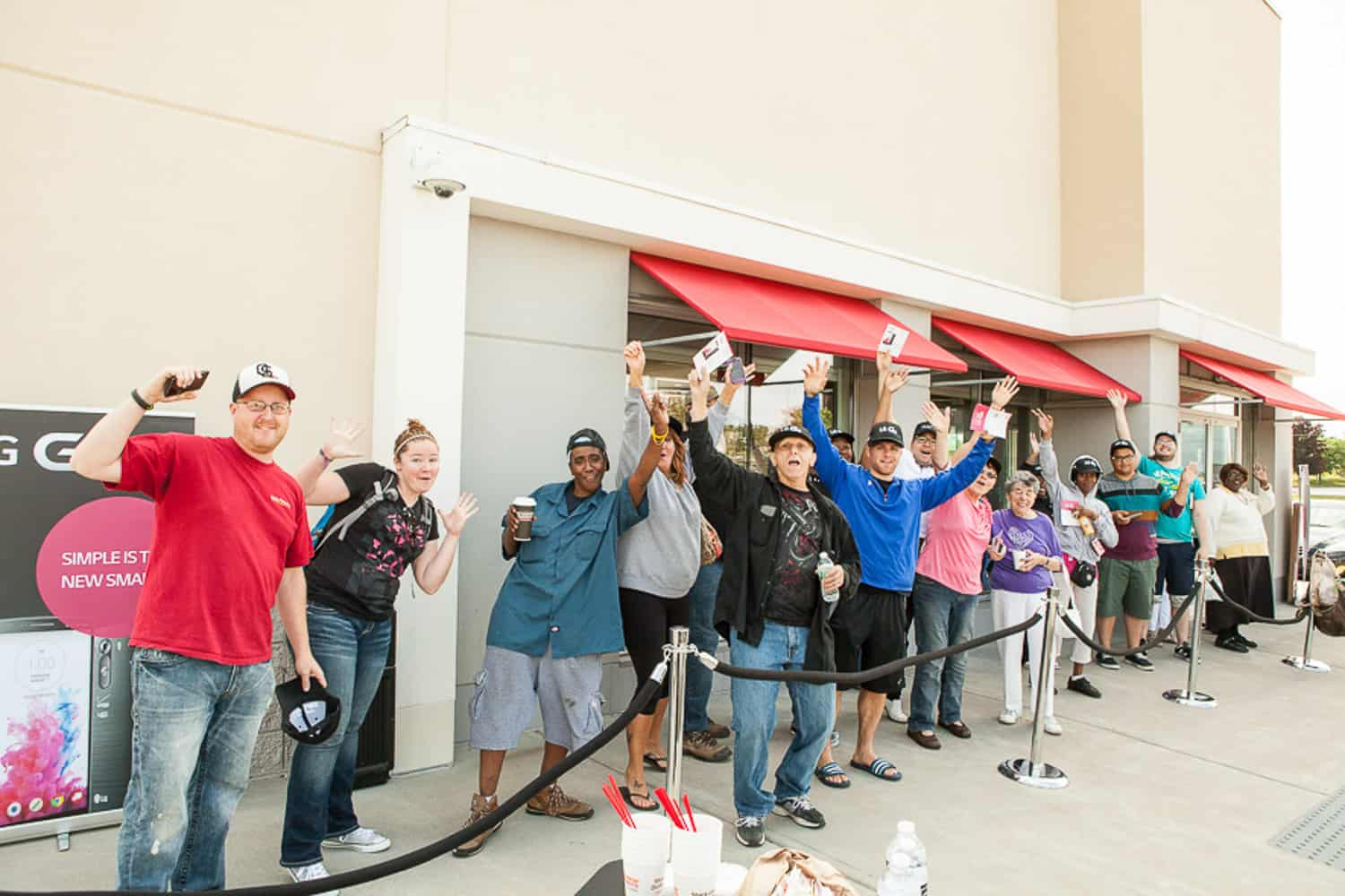 Event photography of people lined up outside of the store.