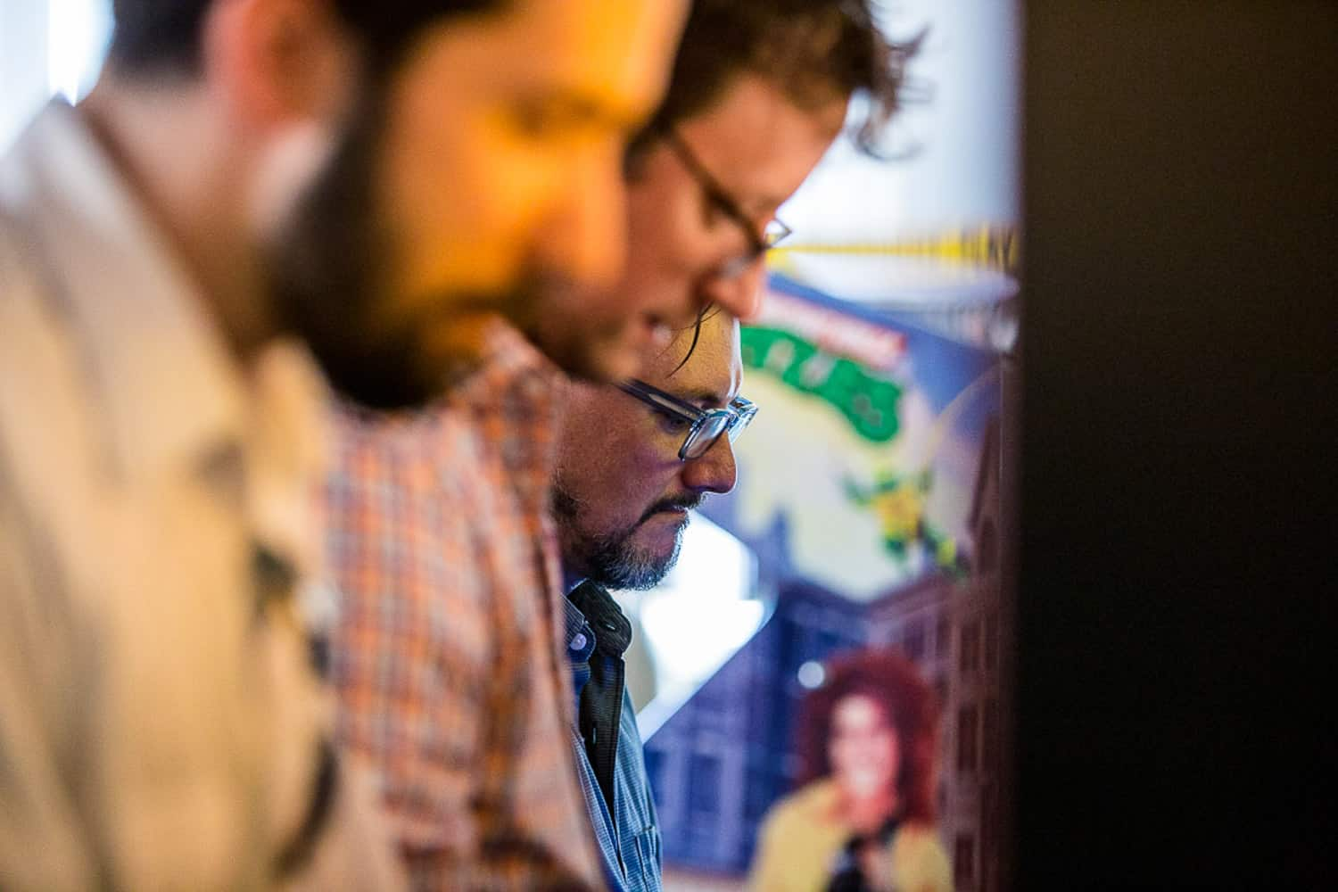 Event photography of a line of Splyce employees playing video games.