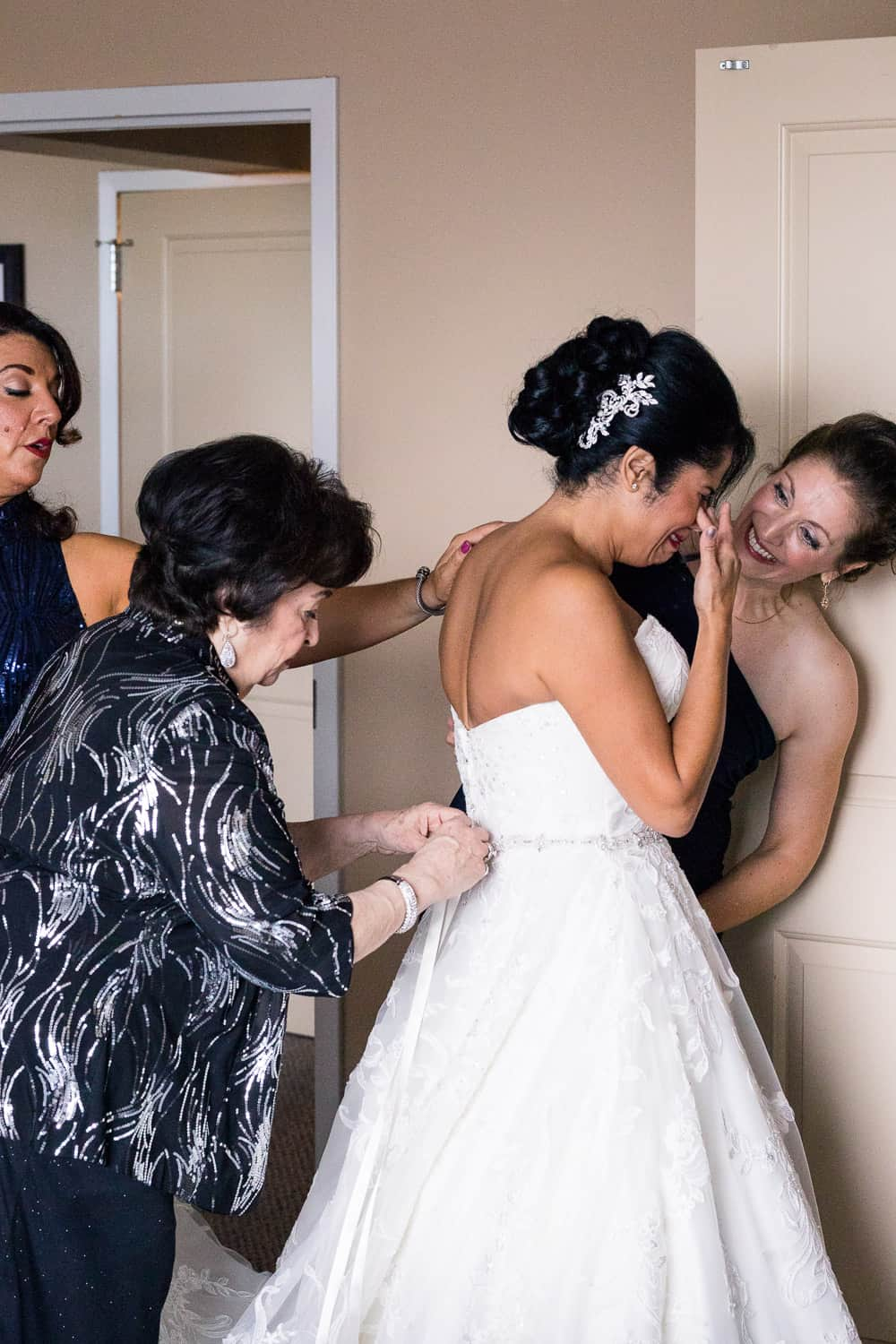 Rosemary putting on her wedding dress at strathallan hotel and crying.