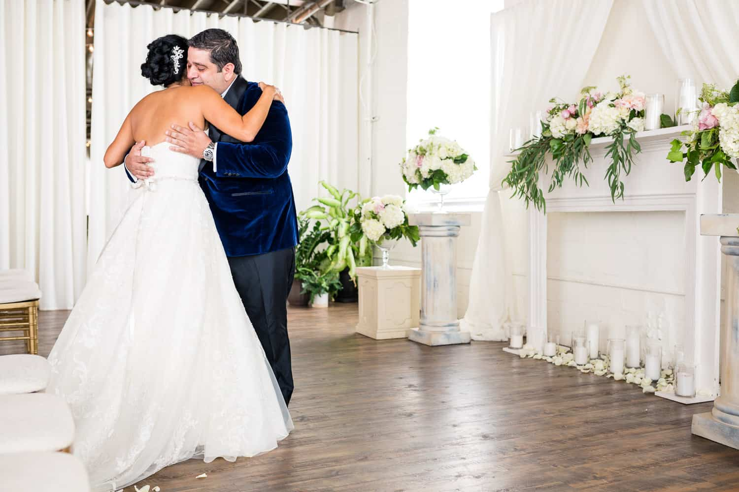 Rosemary and AJ hug during their first look at the Arbor Loft.