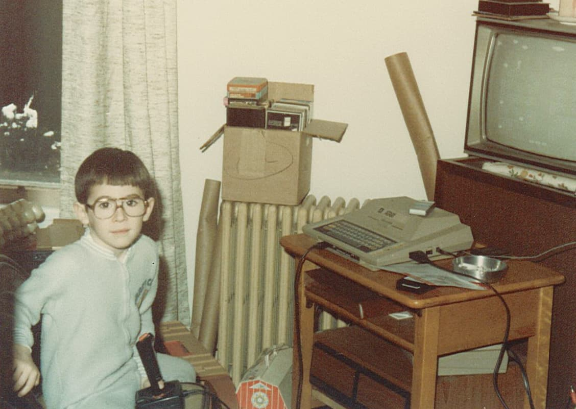 I had a bowl cut and tiny glasses in 1984. Here I am sitting in front of an Atari 400.