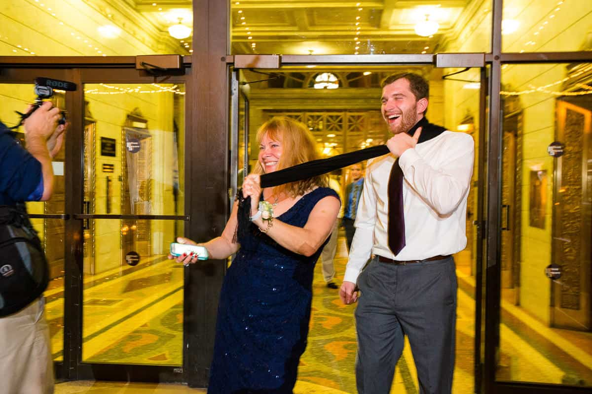 Candid wedding photos of guests in Rochester, NY.