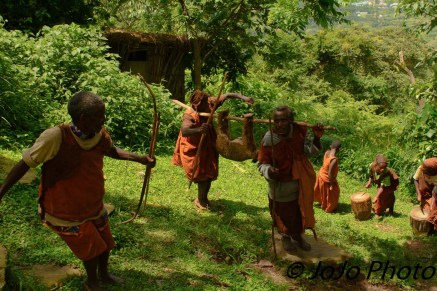 Batwa Pygmy Tribe in a mock hunt in Bwindi National Park