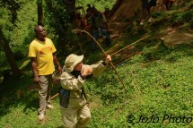Mary practicing bow hunting with the Batwa Pygmy Tribe in Bwindi National Park