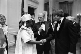 Bruce_Jenner_greets_Gerald_Ford_and_William_Tolbert_in_1976