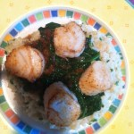 Seared scallops atop risotto and spinach