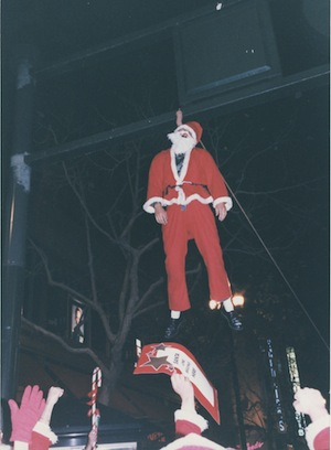 """A very bad Santa pays the price for cavorting in an """"un-Christmas like"""" manner. 2nd SantaCon, San Francisco, CA. December 1995"""