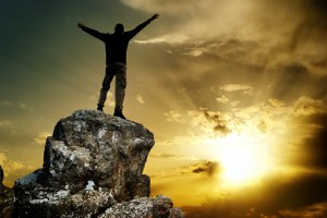 bigstock-Man-on-top-of-mountain-Concep-47176237
