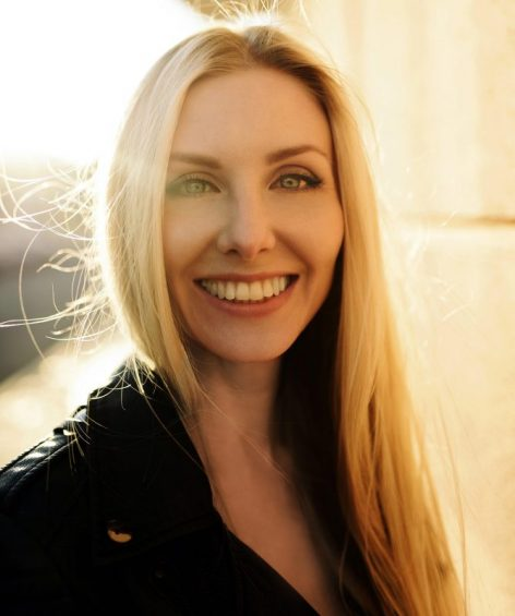 woman smiling with sunshine