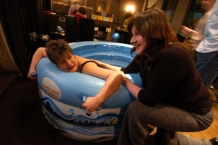 Jo Ind in a birthing pool with an antenatal teacher stroking her back. For Jo Ind's blog: What is a writer?