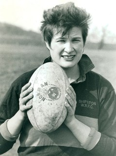 Woman holding a rugby ball