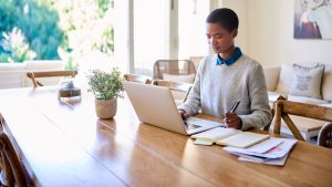 woman focusing on work at home