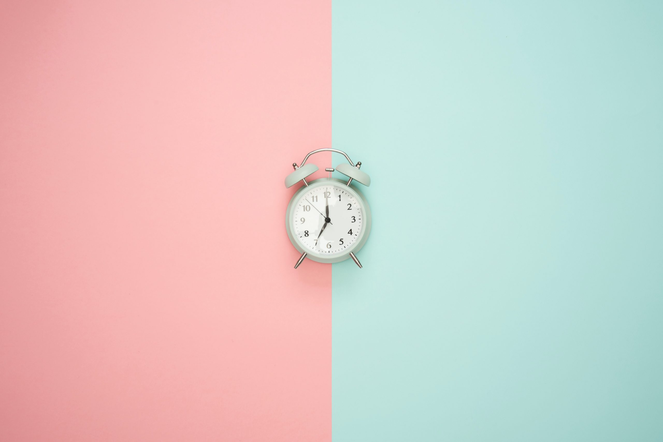 snooze alarm on pastel background
