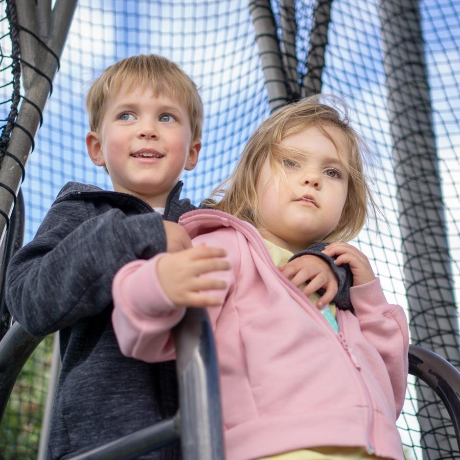 Wellington brother and sister on playground