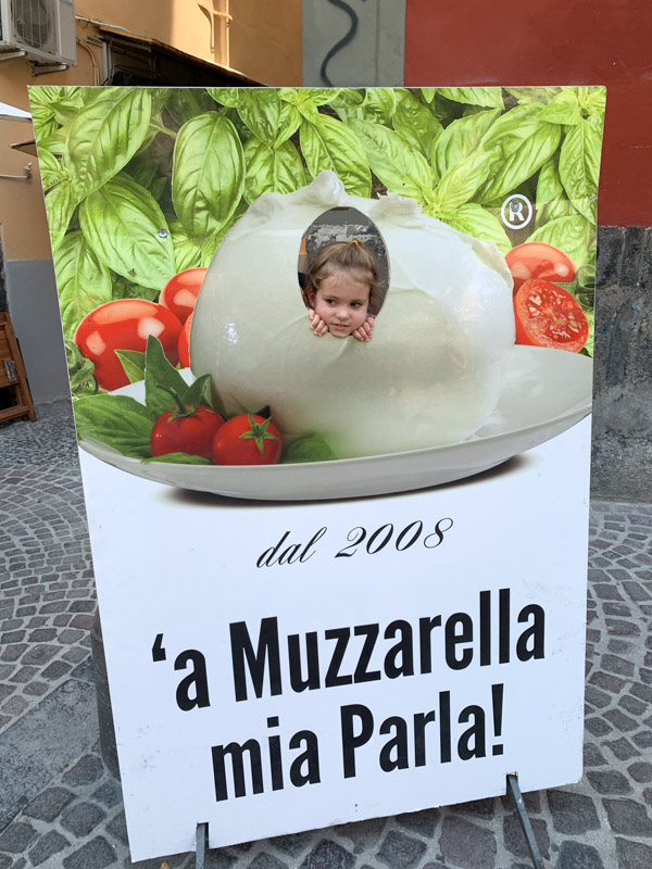 Naples Underground girl in muzzarella sign