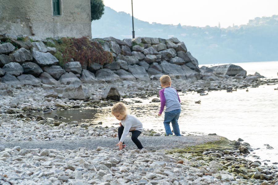 Kids throwing rocks at Lake Como