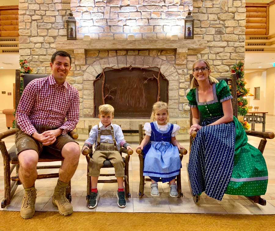 Family posing in traditional Bavarian clothing