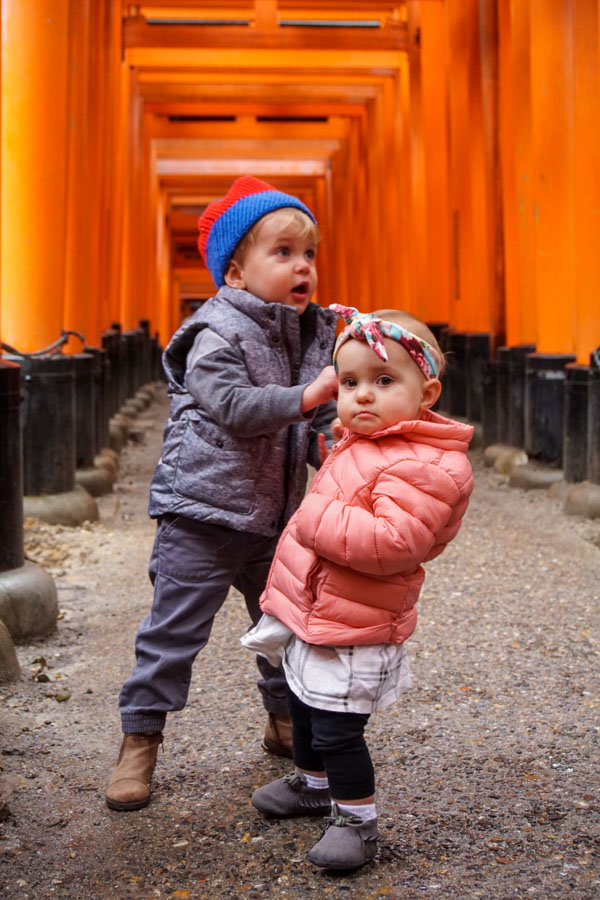 kids under Torii gates in Kyoto