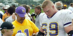 brock lesnar signs an autograph for a vikings fan
