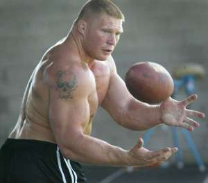 brock lesnar catches a football in 2004
