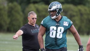 jordan mailata listens to coach jeff stoutland at an eagles practice