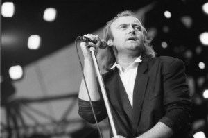 Phil Collins rocking the stage as a lead singer for Genesis in the 80s