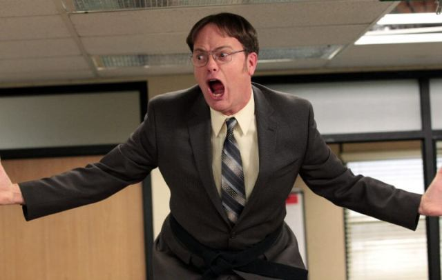 Dwight Schrute freaking out in the office, causing a ruckus.