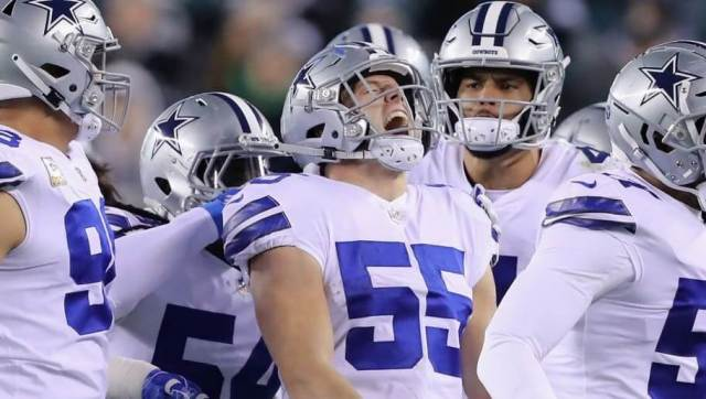Leighton Vander Esch and the Cowboys defense celebrate an interception