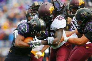 De'Vondre Campbell stuffs the running back in the backfield for the University of Minnesota