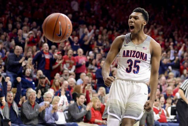 Allonzo Trier celebrates a dunk in a big game at Arizona. Allonzo Trier Undrafted to Rookie Revelation.