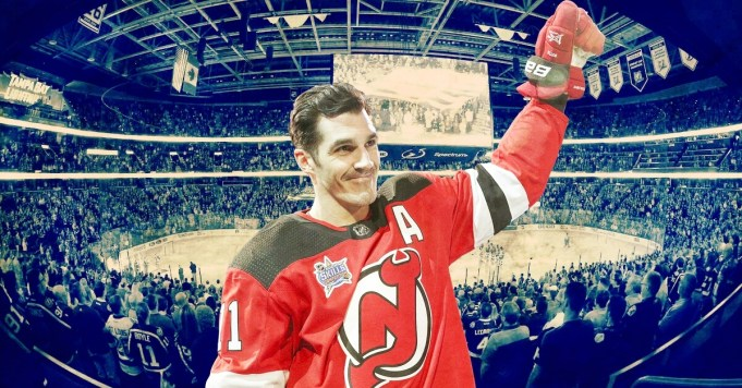 Brian Boyle Cancer and Perseverance cover illustration. Brian Boyle raises his arm in acknowledgement of the cheering fans at the 2018 NHL All-Star Game.