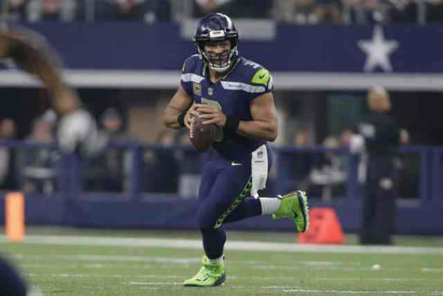 Russell Wilson rolls to his right against the Dallas Cowboys in the 2018 NFL regular season. Wild Card Weekend Sneaky Plays.