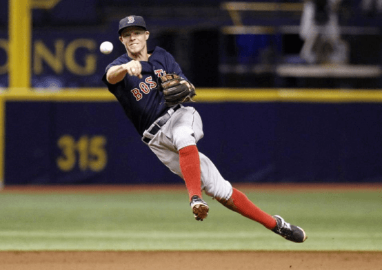 Brock Holt, Boston's glue guy, fires a throw to first at Tropicana Field in Tampa Bay