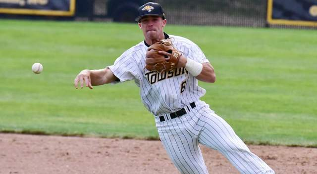 Brady Policelli fires to first base on a tough backhand stop at Towson against Navy