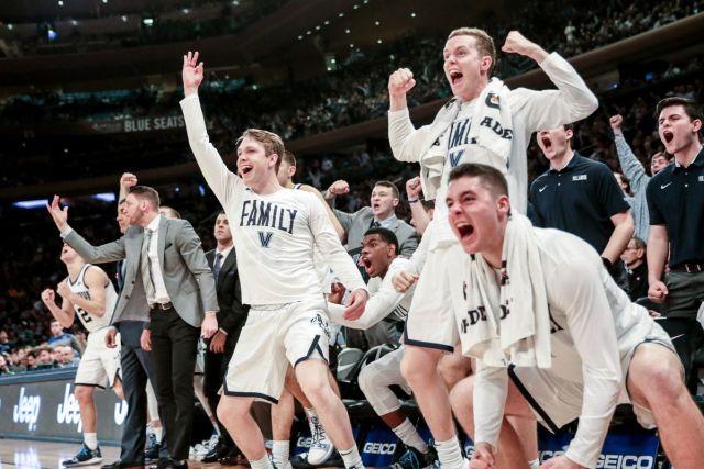 Villanova Basketball bench celebrates winning the 2019 Big East Championship. Taking a look back at the Big East realignment. Jimmy Murray celebrates in the background.