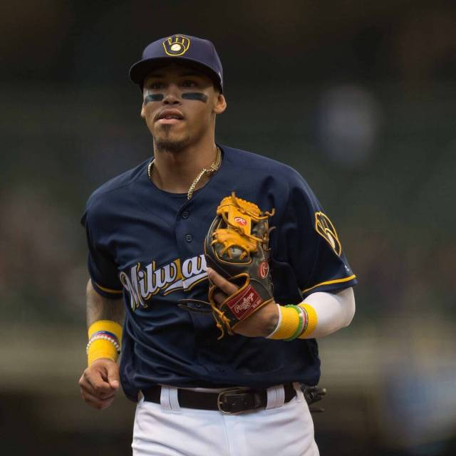 Orlando Arcia trots off the field wearing the Brewers alternate uniform and cap