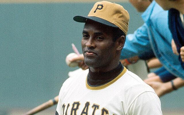 Roberto Clemente wears the Pirates alternate solid gold baseball hat