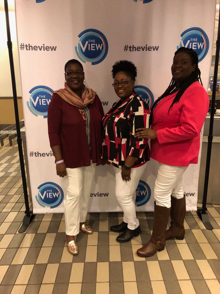 My friends and I at The View. Spot me in the boots I regret buying this year.