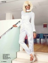 """Jolita feature in Pride Magazine June 2013 editorial """"White Lights"""". A model is wearing a white top and trousers outfit and two statement necklaces by Jolita Jewellery's: Barcelona collar in chartreuse and charcoal silk braid and colourful Damascus necklace"""