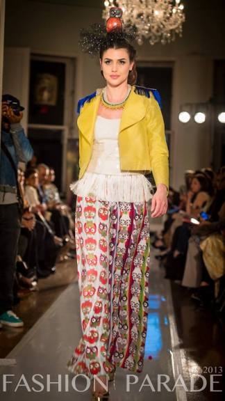 Fashion Parade event, supporting Save The Children charity. A catwalk with Nomi Ansari design and braided Turin statement necklace by Jolita Jewellery.
