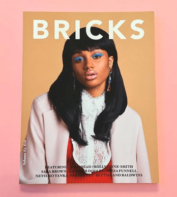 Bricks A/W Cover - in Jolita Jewellery's crystal Countess earrings, hand-made with dipped in gold blue and red crystals