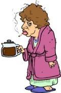 Nő cigarettával és kávéval