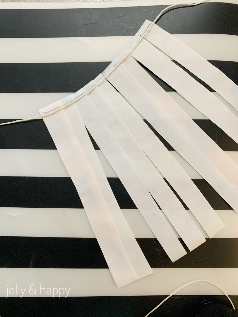 Glue string on DIy banner
