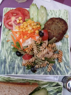 Chicken Burger with No Bun is served with pasta and salad.