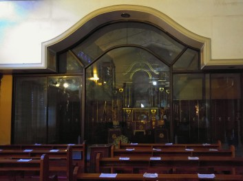 Behind the glass is where the Holy Sacrament is placed after 7am Masses. Prayer to the Holy Sacrament are posted on each pew for the faithful's guidance.