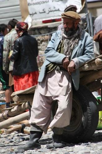 An Afghani man takes a break from hauling stuff into the bazaar. Photo: Helen