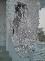 Chiang Rai - white temple decoration 1