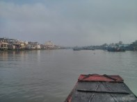 Mekong boat tour - fog clearing up town